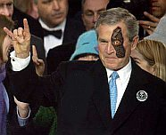 Bush seen here flashing his diablo sign to fellow satanists