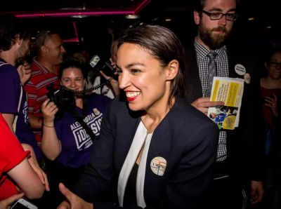 Democratic socialist Alexandria Occasional-Cortex celebrates her win