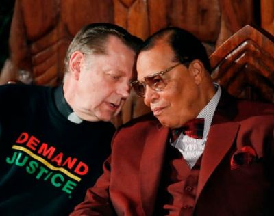 Father Michael Pfleger talks with Nation of Islam leader Louis Farrakhan