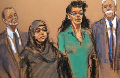 In this courtroom sketch, defendants Noelle Velentzas, center left and Asia Siddiqui, center right, appear in federal court with their attorneys