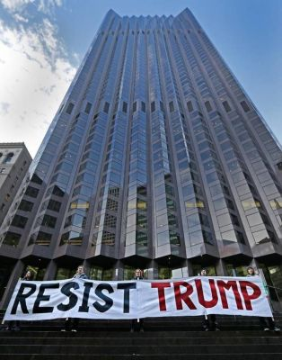 Protesters in San Francisco rally at 555 California St., a partially Trump-owned building.