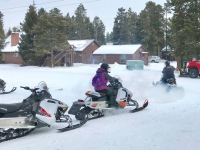 Between 20,000 to 30,000 people visit Yellowstone National Park each month in the winter, many to snowmobile the park's groomed roads and trails