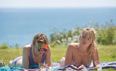 Margot Robbie and Vanessa Kirby in About Time, filmed at Vault Beach