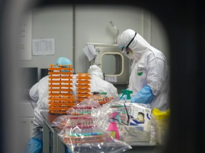 Medical workers in protective suits at a coronavirus detection lab in Wuhan in central China's Hubei Province