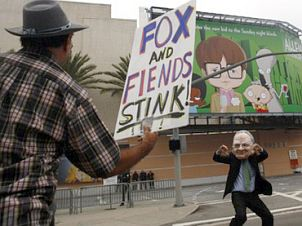 Protesters demonstrate the annual shareholder meeting of News Corp at Fox Studios