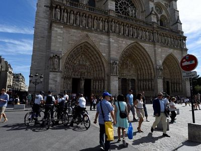 Police officers patrol Notre Dame Cathedral in Paris