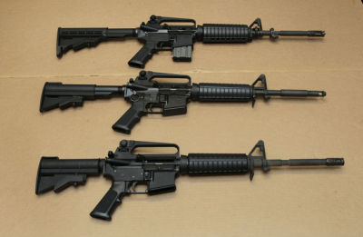 Three variations of the AR-15 assault rifle are displayed at the California Department of Justice