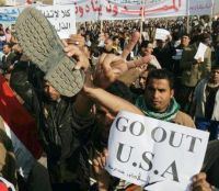 A protester waves his shoe in a demonstration against President George W. Bush