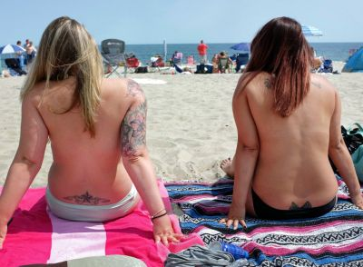 Women participate in Go Topless Day at Hampton Beach